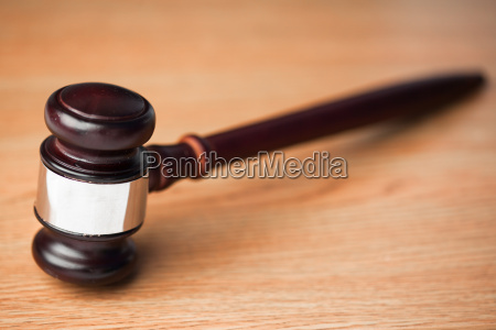 wood gavel on a wooden desk
