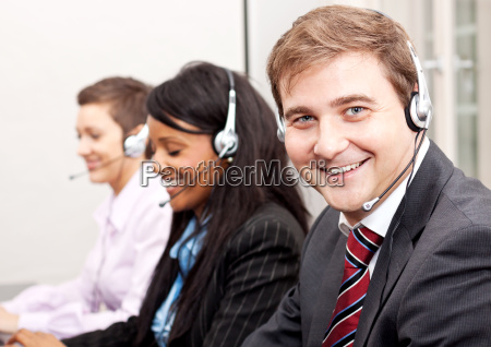 team in callcenter with headset while
