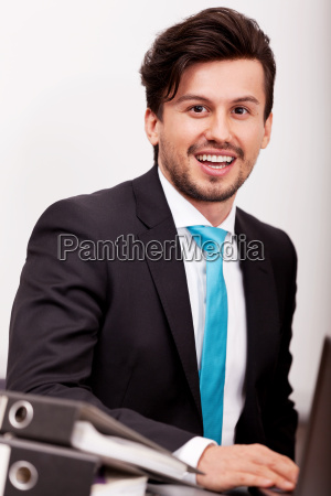 young man broker with suit and