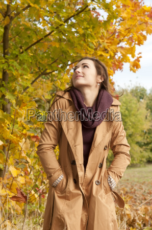 happy young woman in autumnal park
