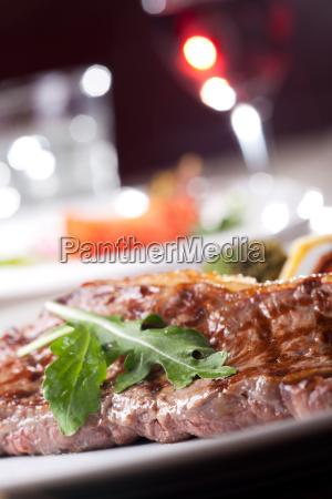 grilled sirloin steak with rocket