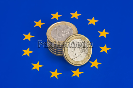 euro coins on the eu flag