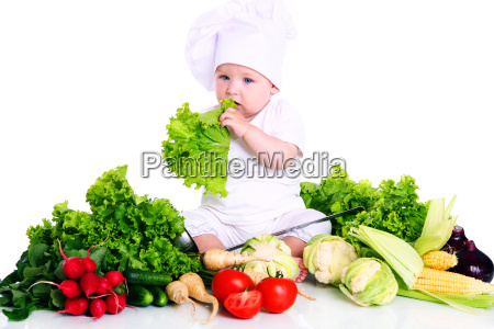 baby cook with fresh vegetables