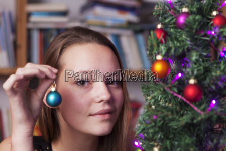 young woman and decoration for christmas