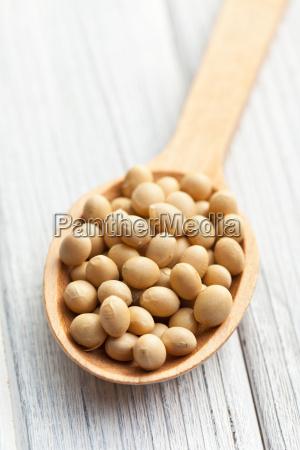 soybeans in wooden spoon