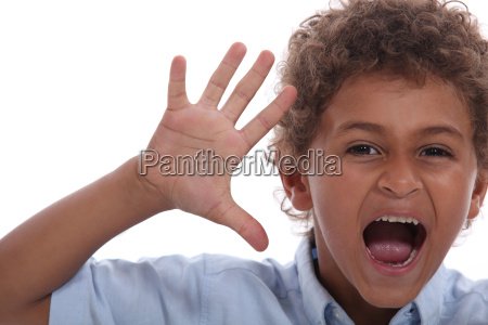 little boy with raised hand