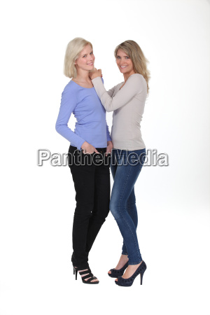 sisters stood together in studio