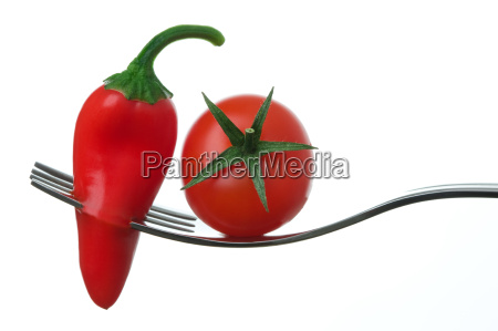 chili pepper and tomato on a