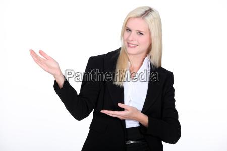 businesswoman gesturing at copyspace