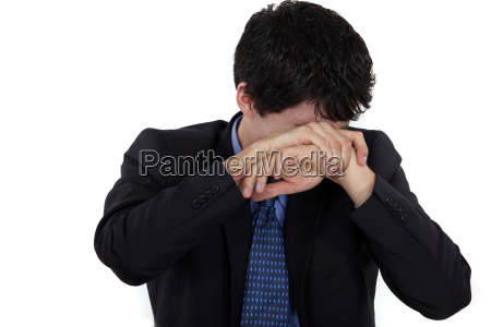 man hiding his face in shame