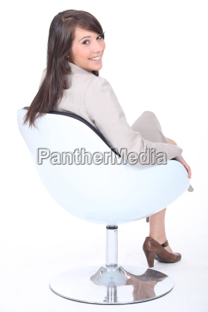 happy young businesswoman in a swivel