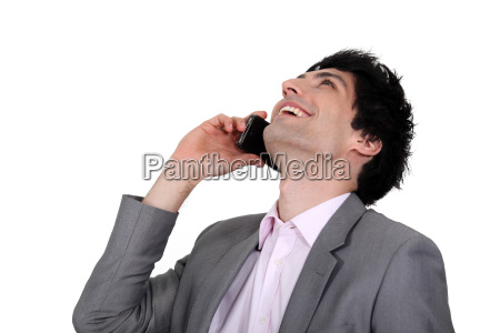 man laughing on the phone