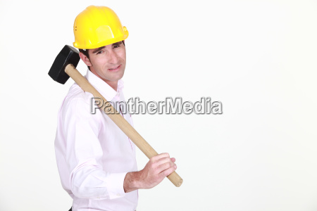 businessman holding a helmet and a
