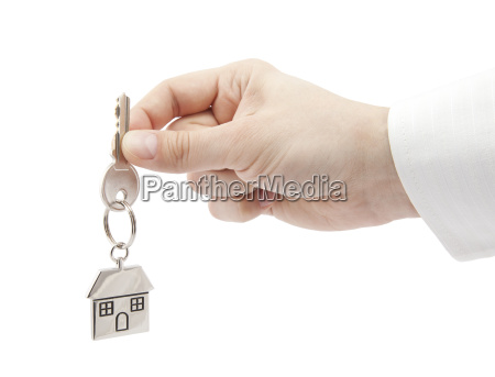 house key in hand with clipping