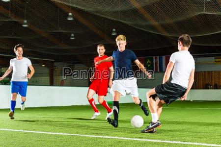 team plays indoor soccer