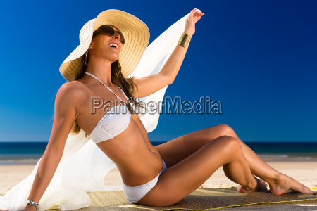 attractive woman in bikini sitting in