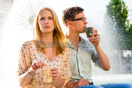 couple enjoying coffee from a mug