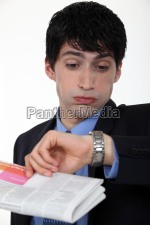 businessman staring at his watch in
