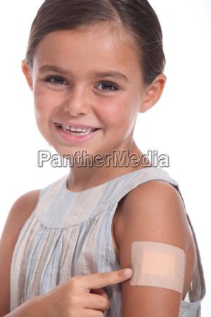a girl wearing an adhesive bandage