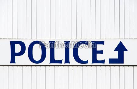 blue signposts england belgium policeman small