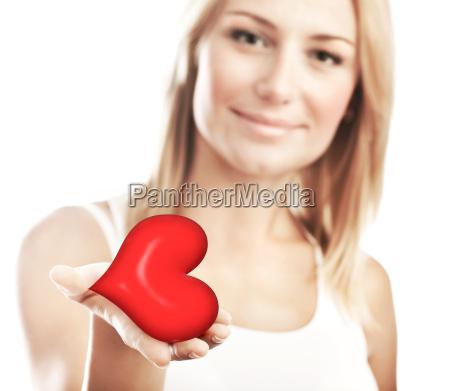 beautiful woman holding heart selective focus