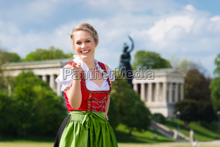 young woman in a dirndl before