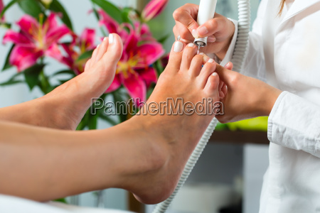 woman in beauty salon gets pedicures
