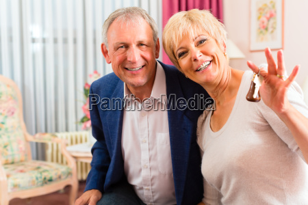 elderly couple on bed in hotel