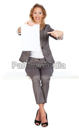 woman sits thumbs up