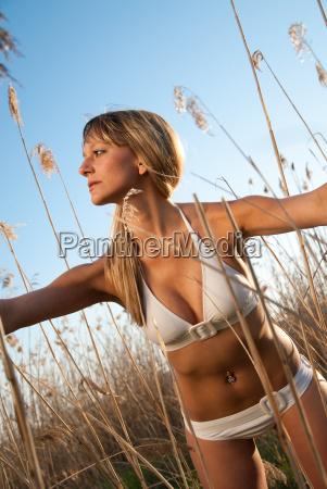 young woman in bikini standing in