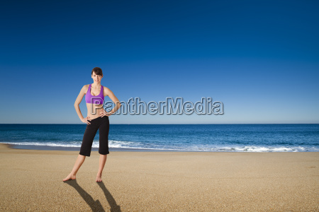 athletic woman in the beach