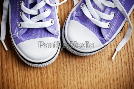 colorful sneakers on wooden floor