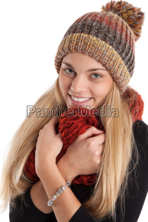 young woman cuddling in woolen scarf