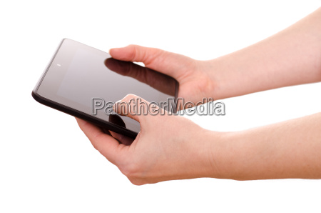 two hands holding a tablet computer