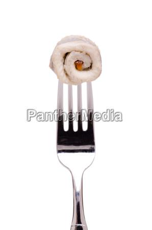 fillet of herring on a fork
