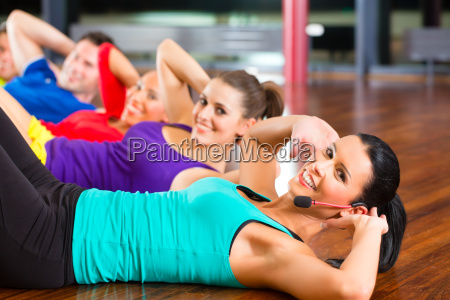 group during stretching in the gym