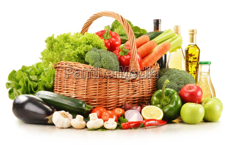 raw vegetables in wicker basket isolated
