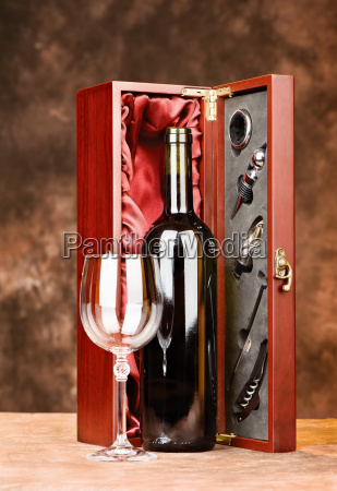 vintage wine with glasses and case