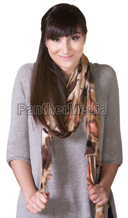 cheerful woman pulling on scarf