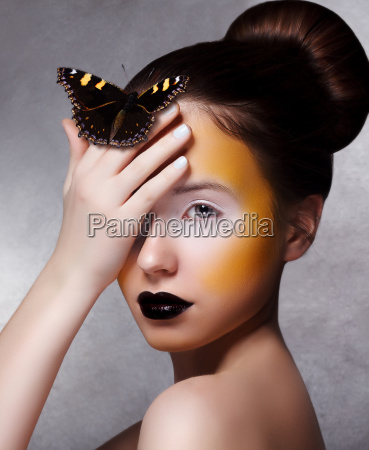 trendy woman with butterfly creative bright