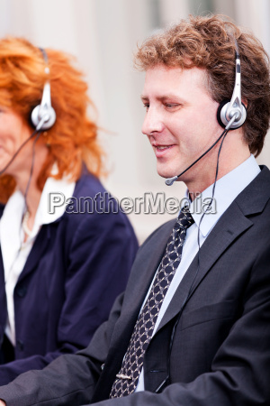 team in call center with headset