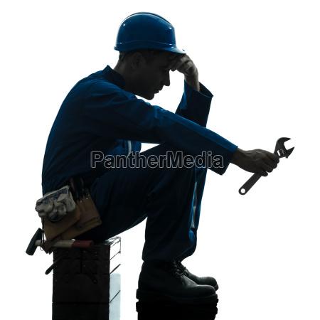 repair man worker sad fatigue failure