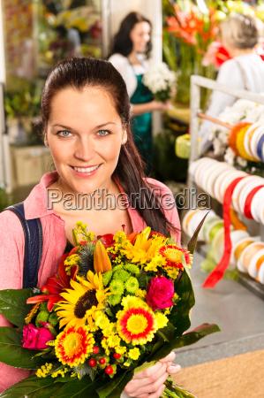 smiling young florist woman colorful bouquet