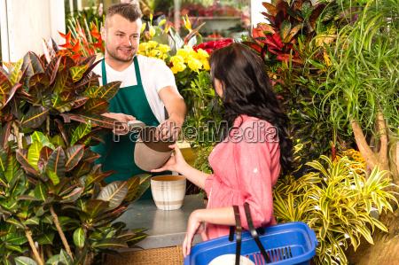 man selling pot woman customer flower