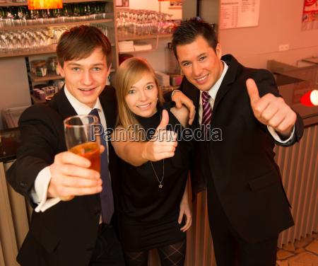 three friends in a bar