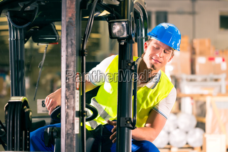 forklift truck in warehouse by speditionng