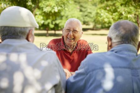 group of senior men having fun