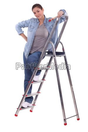 painter standing on a stepladder
