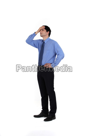 portrait of young businessman having remorse