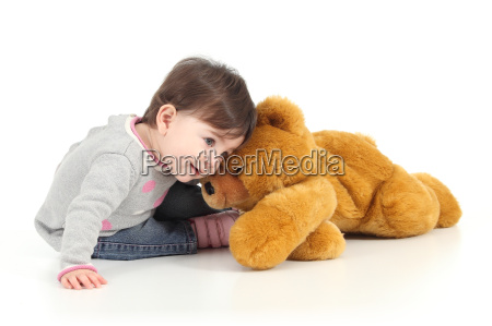 baby playing with a teddy bear